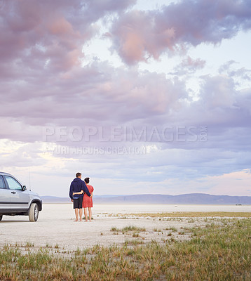 Buy stock photo Shot of a young couple going on a desert road trip