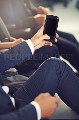 Buy stock photo Closeup shot of an unrecognizable businessman using a cellphone while attending a seminar