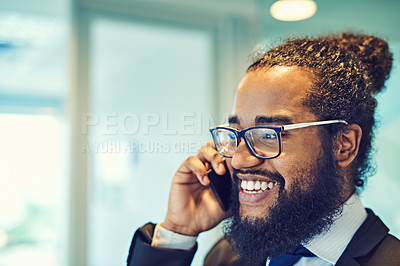 Buy stock photo Cropped shot of a handsome young businessman on call in a modern office