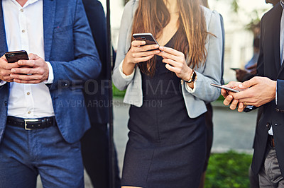 Buy stock photo Cropped shot of unrecognizable businesspeople using cellphones outside