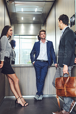 Buy stock photo Shot of businesspeople in an elevator