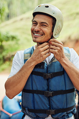 Buy stock photo Cropped shot of a young man adjusting his helmet