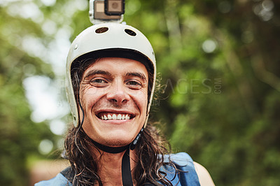 Buy stock photo Cropped shot of an adventurous young man wearing a helmet with a action camera attached
