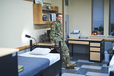 Buy stock photo Shot of a young soldier in the dorms of a military academy