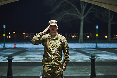 Buy stock photo Shot of a young soldier standing at a military academy and saluting