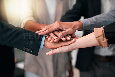 Buy stock photo Cropped shot of a group of unrecognizable businesspeople standing in the office with their hands in a huddle