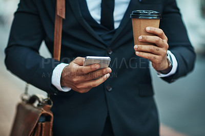 Buy stock photo Shot of an unrecognizable businessman in the city