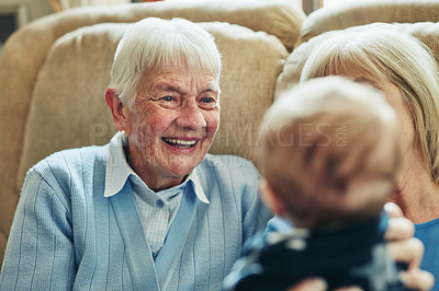 Buy stock photo Shot of a grandmother bonding with her family at home