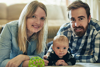Buy stock photo Portrait of a mother and father bonding with their baby boy at home