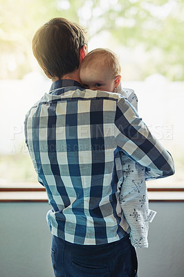 Buy stock photo Shot of a father bonding with his baby boy at home