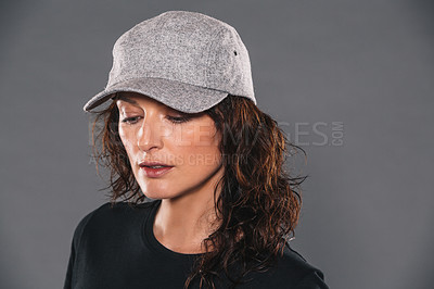 Buy stock photo Studio shot of an attractive and trendy woman posing against a gray background