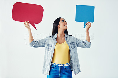 Buy stock photo Studio shot of an attractive young woman holding speech bubbles