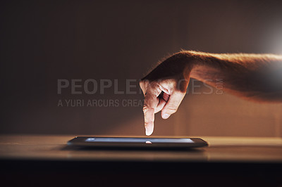 Buy stock photo Cropped shot of an unrecognizable male designer working on a digital tablet in his office