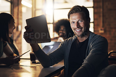 Buy stock photo Cropped portrait of a handsome young male designer sitting in the boardroom during a meeting