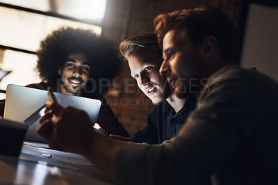 Buy stock photo Cropped shot of a group of young designers having a brainstorming session in the boardroom