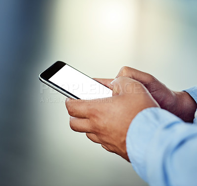 Buy stock photo Cropped shot of a businessman using a mobile phone in an office