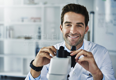 Buy stock photo Portrait of a scientist using a microscope in a lab