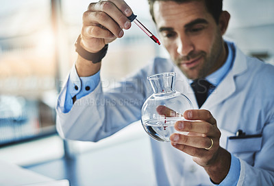 Buy stock photo Cropped shot of a male forensic analyst working in his laboratory