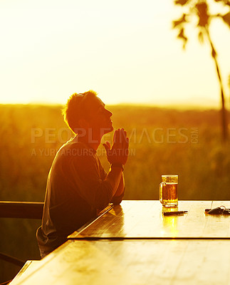 Buy stock photo Cropped shot of a young man having a drink outside at  a resort in nature