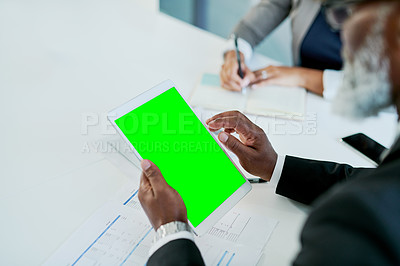 Buy stock photo Closeup shot of an unrecognizable businessman using a digital tablet with a green screen in an office