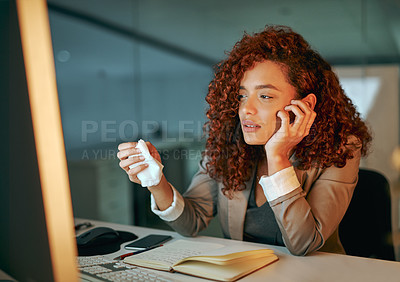 Buy stock photo Shot of a young businesswoman looking ill while working late in an office
