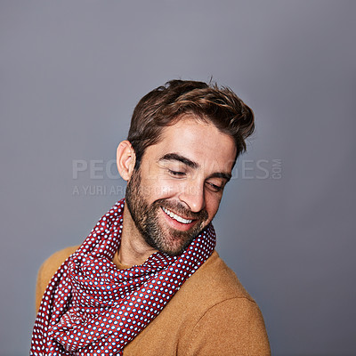 Buy stock photo Studio shot of a handsome young man posing against a grey background