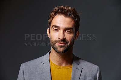 Buy stock photo Studio portrait of a handsome young businessman standing against a grey background