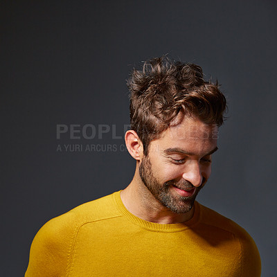 Buy stock photo Studio shot of a handsome man posing against a grey background