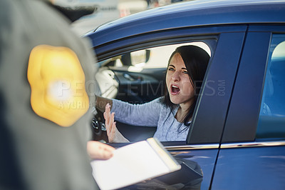 Buy stock photo Cropped shot of an unrecognizable male traffic officer issuing a ticket to a female civilian at a roadblock