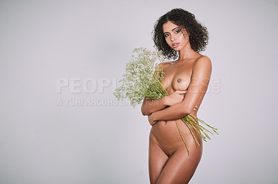 Buy stock photo Studio shot of a sexy young woman posing nude against a gray background