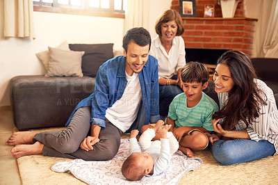 Buy stock photo Full length shot of an affectionate young family spending quality time together at home