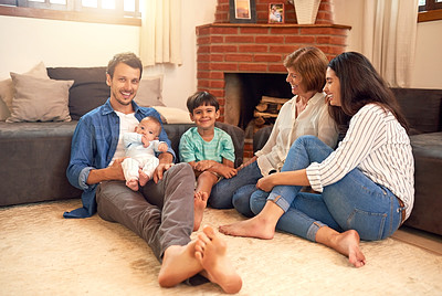 Buy stock photo Full length portrait of an affectionate young family spending quality time together at home