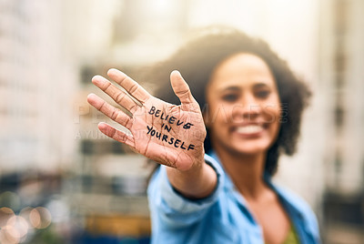Buy stock photo Cropped shot of a woman showing a motivational message written on her hand