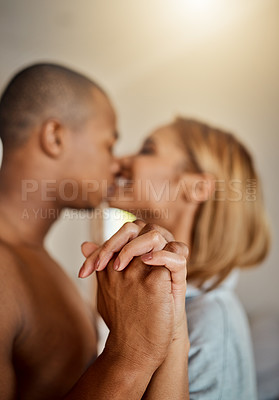 Buy stock photo Shot of an affectionate young couple in their bedroom