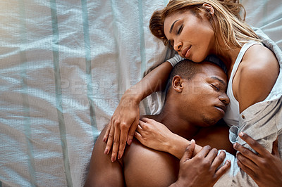 Buy stock photo Cropped shot of an affectionate young couple taking a nap together
