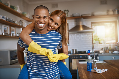 Buy stock photo Shot of a young couple having fun while cleaning up at home