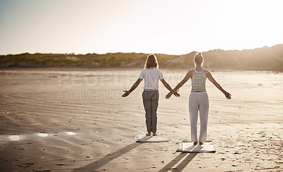 Buy stock photo Rearview shot of an unrecognizable couple practising yoga on the beach