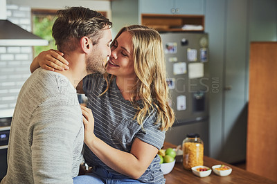 Buy stock photo Shot of an affectionate young couple spending time together at home