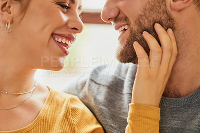 Buy stock photo Closeup shot of a young couple being affectionate in the living room at home