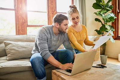 Buy stock photo Shot of a young couple planning their home budget in the living room at home