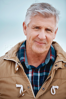 Buy stock photo Cropped portrait of a handsome senior man standing outside