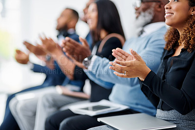 Buy stock photo Cropped shot of a group of businesspeople sitting in line and clapping