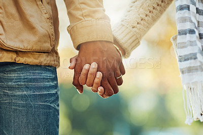 Buy stock photo Rearview shot of an unrecognizable couple walking in a public park outside