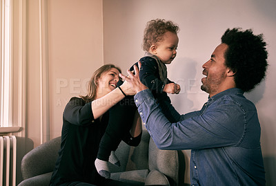 Buy stock photo Cropped shot of a happy couple and their baby boy spending time together at home