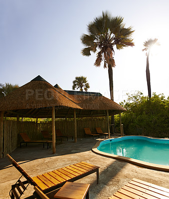 Buy stock photo Shot of the outside pool area of a luxurious holiday resort during the day