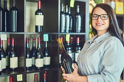 Buy stock photo Portrait of a young sommelier in a wine cellar