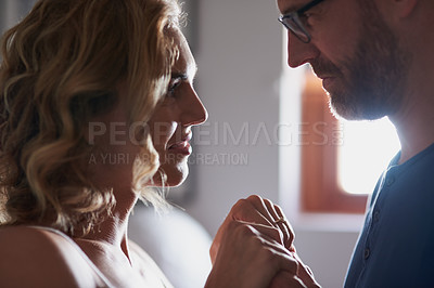 Buy stock photo Shot of a happy middle aged couple bonding at home