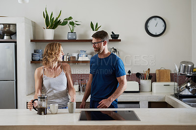 Buy stock photo Shot of a happy middle aged couple having coffee together in the kitchen at home