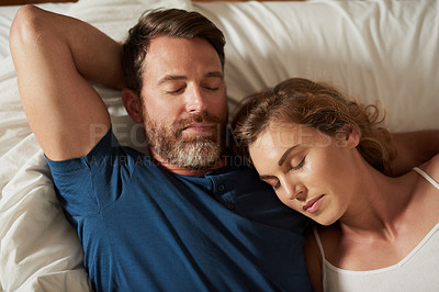 Buy stock photo Shot of a happy middle aged couple relaxing in bed together