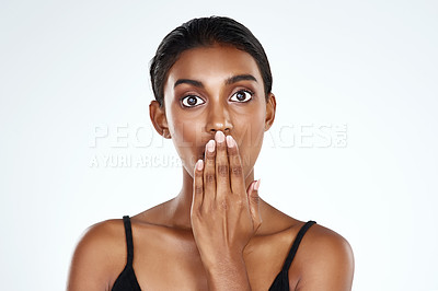Buy stock photo Studio shot of a beautiful young woman looking surprised against a light background
